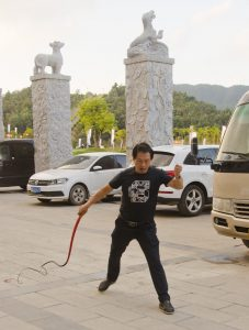 A whip lesson in front of the hotel, with Zhengzhou team trainer